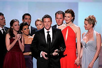 Doug Savant accepts, with James Denton, Heather Stephens, Eva Longoria, Jesse Metcalfe, Felicity Huffman, Mark Moses, Brenda Strong and Nicollette Sheridan of &quot;Desperate Housewives&quot;