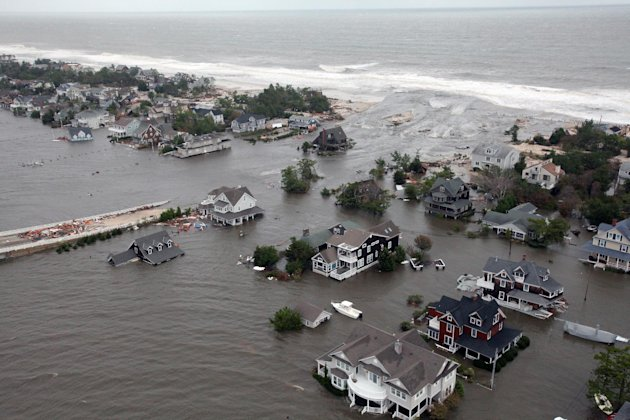 FILE - This Oct. 30, 2012 aerial file photo provided by the U.S. Air Force shows flooding on the New Jersey shoreline caused by Superstorm Sandy. The unprecedented storm surge caused by the storm caus