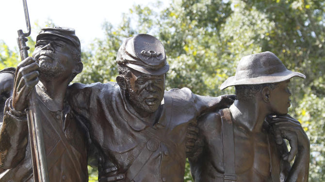 This nine-foot tall sculpture photographed at the Vicksburg National Military Park in Vicksburg, Miss., Thursday, Aug. 16, 2012, honors black soldiers and civilians that fought for their freedom and in support of the Union. The statue depicts three figures - two Union soldiers representing the 1st and 3d Mississippi Infantry, African Descent, and participated in the Vicksburg campaign, and the third figure, right, is a civilian laborer. (AP Photo/Rogelio V. Solis)