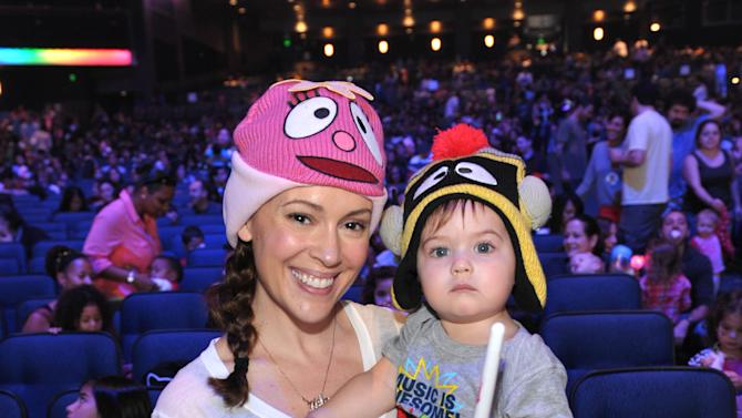 IMAGE DISTRIBUTED FOR GABBA CA DABRA - Alyssa Milano, left, and son Milo Bugliari attend attend Yo Gabba Gabba! Live!: Get The Sillies Out! 50+ city tour kick-off performance on Thanksgiving weekend at Nokia Theatre L.A. Live on Friday Nov. 23, 2012 in Los Angeles. (Photo by John Shearer/Invision for GabbaCaDabra, LLC./AP Images)