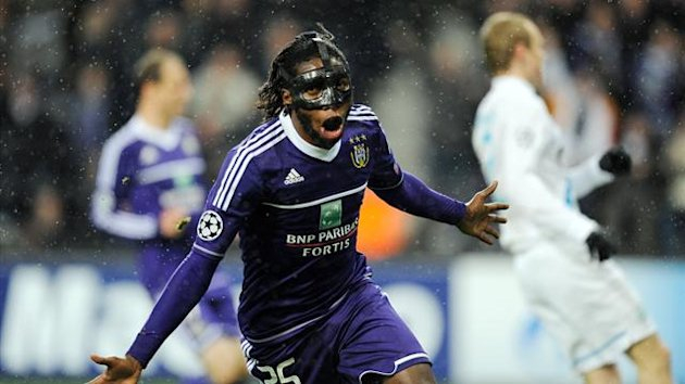 : Anderlecht's Dieumerci Mbokani celebrates after scoring a goal during an UEFA Champions League group C football match against Zenit St Petersburg at the Constant Vanden Stock Stadium