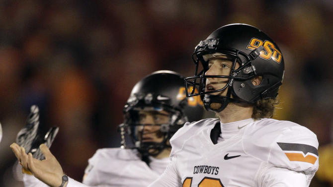 Oklahoma State kicker Quinn Sharp reacts after missing a field goal during the final minutes of an NCAA college football game against Iowa State, Friday, Nov. 18, 2011, in Ames, Iowa.  Iowa State won 37-31 in double overtime. (AP Photo/Charlie Neibergall)