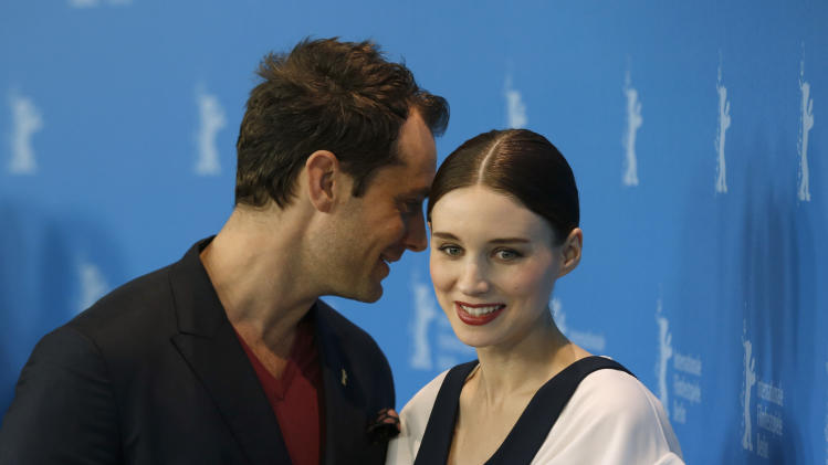 Actors Jude Law and Rooney Mara pose for photographers at the photo call for the film Side Effects at the 63rd edition of the Berlinale, International Film Festival in Berlin, Tuesday, Feb. 12, 2013. (AP Photo/Gero Breloer)
