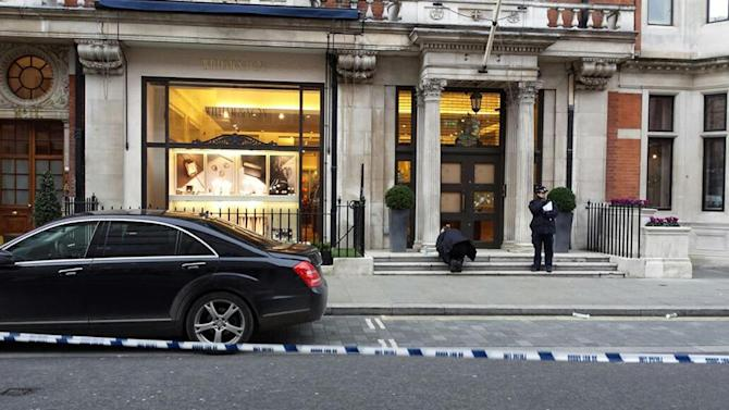 Police outside the jeweller to the royal household in London's Mayfair following a smash and grab raid by thieves reportedly carrying metal baseball bats.
