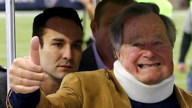 Former U.S. President George H. W. Bush makes an appearance before the start of the NFL football game in Houston, Texas