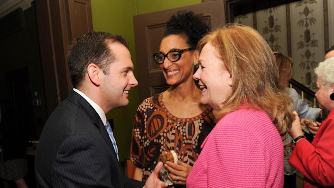 "IMAGE DISTRIBUTED FOR CHASE SAPPHIRE PREFERRED - Director of Marketing for Chase Sapphire Preferred, Jeff Bedard, left, chats with  James Beard Foundation president Susan Ungaro, right and chef Carla Hall at the kick-off event for the James Beard Foundation's ""Taste America"" traveling food festival presented by Chase Sapphire Preferred Visa Signature at the James Beard House on Wednesday, June 12, 2013 in New York City, New York. (Photo by Evan Agostini/Invision for Chase Sapphire Preferred/AP Images)"