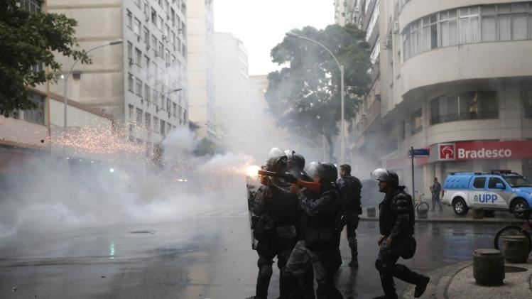 Rio policemen clash with residents of Pavao-Pavaozinho slum during a protest against the death of Douglas Rafael da Silva Pereira in Rio de Janeiro