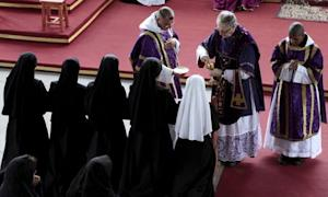 French Bishop Jean-Michel Faure gives holy communions during a mass in Nova Friburgo