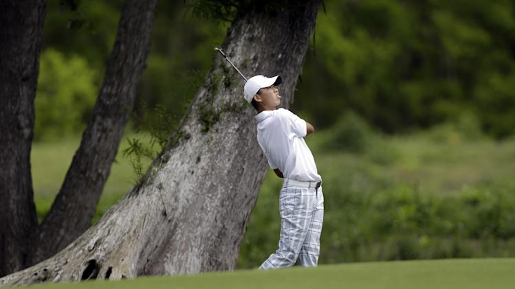 Guan Tianlang, 14, from China, hits on the second hole during the first round of the PGA Tour Zurich Classic golf tournament at TPC Louisiana in Avondale, La., Thursday, April 25, 2013. (AP Photo/Gerald Herbert)