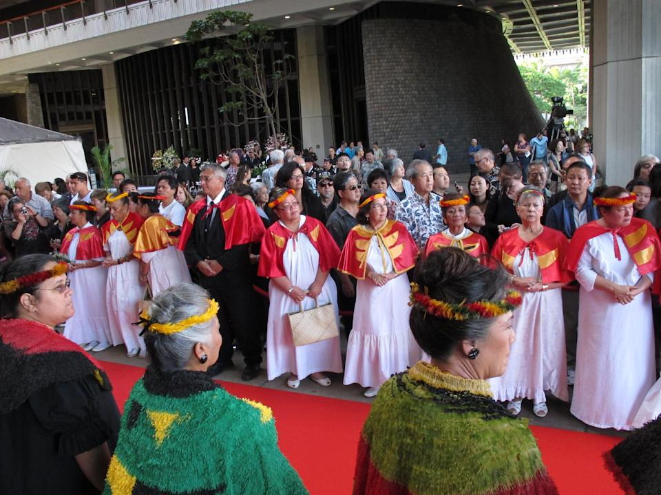 Members of the public wait for the casket to arrive at a visitation service for U.S. Sen. Daniel Inouye at the Hawaii state Capitol in Honolulu on, Dec. 22, 2012. (AP Photo/Oskar Garcia)