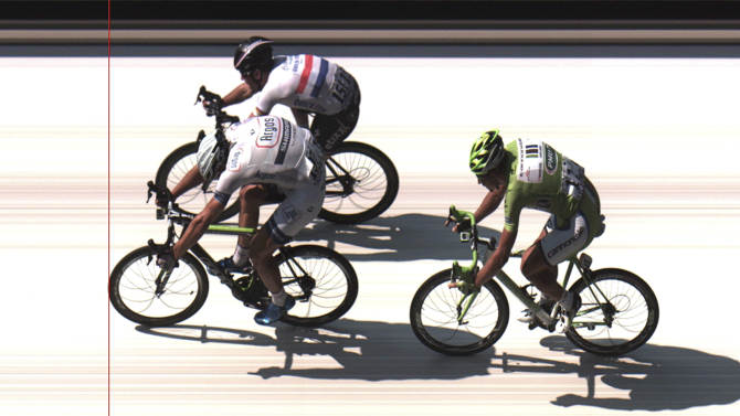 In this photo finish image provided by ASO, Marcel Kittel of Germany, front, crosses the finish line ahead of second place Mark Cavendish of Britain, rear, and third place Peter Sagan of Slovakia, right, to win the twelfth stage of the Tour de France cycling race over 218 kilometers (136.2 miles) with start in in Fougeres and finish in Tours, western France, Thursday July 11 2013. (AP Photo/ASO, HO)