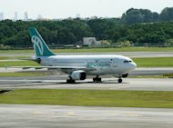 This file photo shows Myanmar's Air Bagan plane taxiing along the tarmac after arriving at the Changi International Airport in Singapore, on September 7, 2007. An Air Bagan plane carrying 65 passengers was forced to make an emergency landing near an airport in eastern Shan state on Tuesday, leaving two pilots injured, the airline said
