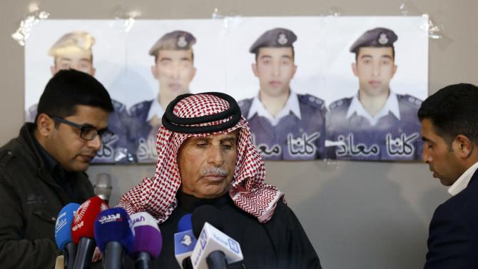 Yousef, father of Islamic State captive Jordanian pilot Kasaesbeh, stands before a news conference where he asked Islamic State to pardon and release his son, in Amman