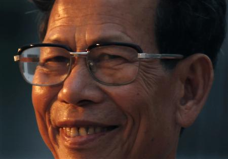 File photo of Lin Zuluan smiling during vote counting before being elected as village chief in Wukan