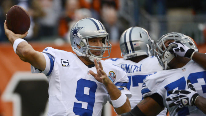 Dallas Cowboys quarterback Tony Romo (9) passes against the Cincinnati Bengals in the first half of an NFL football game, Sunday, Dec. 9, 2012, in Cincinnati. (AP Photo/Michael Keating)