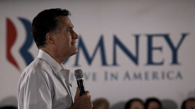 Republican presidential candidate, former Massachusetts Gov. Mitt Romney listens to a question during a campaign stop Saturday, March 17, 2012 in Collinsville, Ill. Romney wrapped up a shortened campaign trip to Puerto Rico on Saturday in favor of spending more time in Illinois, where polls have shown him slightly ahead of chief rival Rick Santorum. (AP Photo/Charlie Riedel)