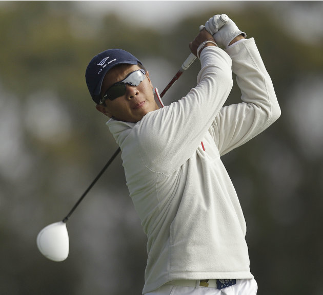 Andy Zhang hits a drive on the second hole during a practice round for the U.S. Open Championship golf tournament Thursday, June 14, 2012, at The Olympic Club in San Francisco. (AP Photo/Ben Margot)