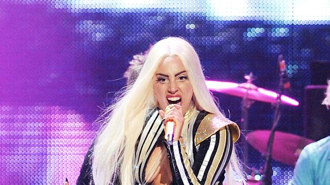 """FILE - This Dec. 15, 2012 file photo shows singer Lady Gaga performing at the Prudential Center in Newark, N.J. Lady Gaga says she's completed surgery to fix her hip. The singer posted on her blog late Wednesday that she had hip surgery and that it """"happened so fast."""" She canceled her """"Born This Way Ball"""" tour last week. (Photo by Evan Agostini/Invision/AP, file)"""