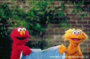 Elmo and Zoe play tug-of-war in The Adventures of Elmo In Grouchland