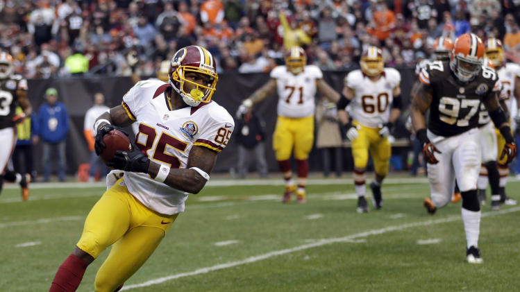 Washington Redskins wide receiver Leonard Hankerson (85) runs free to the end zone on a 2-yard touchdown catch against the Cleveland Browns in the third quarter of an NFL football game on Sunday, Dec. 16, 2012, in Cleveland. (AP Photo/Tony Dejak)