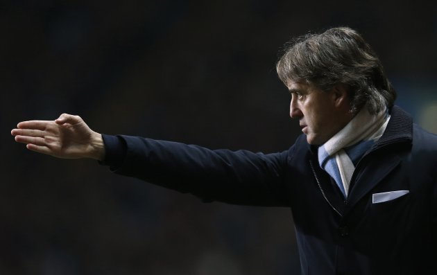 Manchester City manager Roberto Mancini gestures during their English Premier League soccer match against Aston Villa at Villa Park in Birmingham
