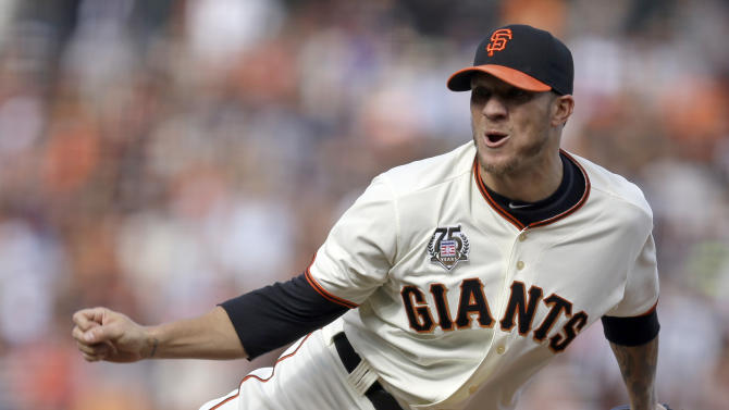 San Francisco Giants' Jake Peavy works against the Los Angeles Dodgers in the first inning of a baseball game Sunday, July 27, 2014, in San Francisco. (AP Photo/Ben Margo)