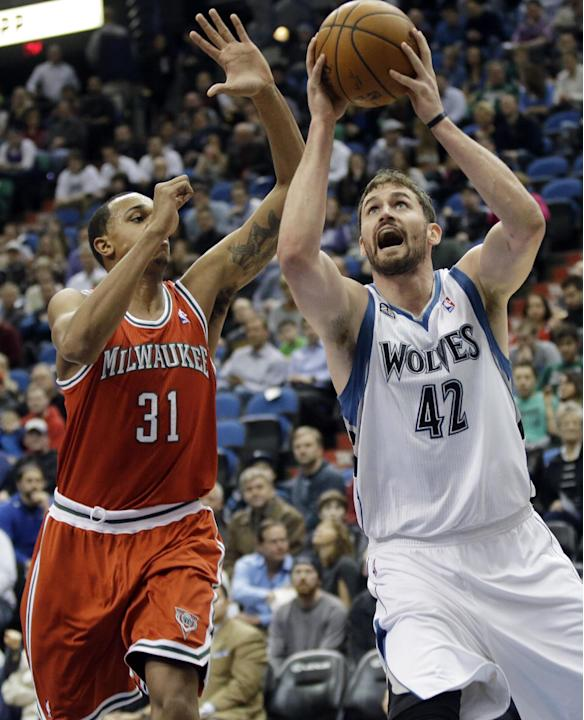Minnesota Timberwolves' Kevin Love, right, shoots as Milwaukee Bucks' John Henson defends in the first quarter of an NBA basketball game, Tuesday, March 11, 2014, in Minneapolis