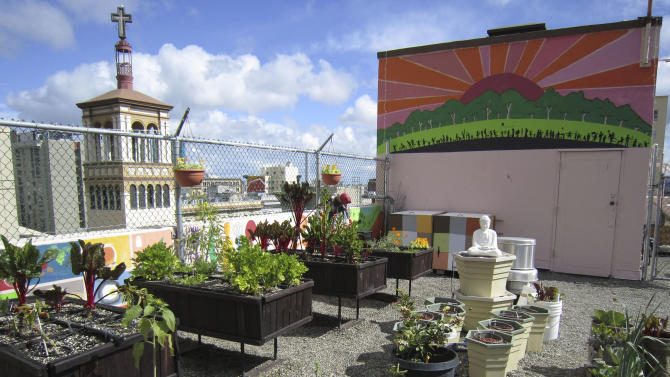 This undated photo courtesy of Joyce Sood for the GLIDE Foundation shows the rooftop garden at the Glide Memorial Church in San Francisco. As more people turn to roof gardens to grow their own food, they are coming up with all kinds of ways to keep those gardens light and avoid sagging and cave-ins.   (AP Photo/GLIDE Foundation, Joyce Sood) NO SALES