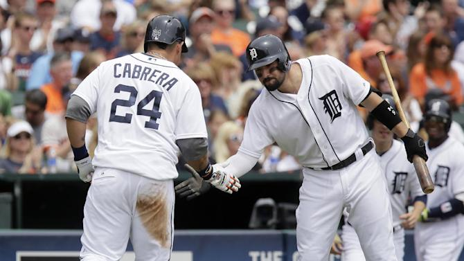 Detroit Tigers' Miguel Cabrera (24) is congratulated by Nick Castellanos after scoring on single by Yoenis Cespedes during the first inning of a baseball game against the Houston Astros Sunday, May 24, 2015, in Detroit. (AP Photo/Duane Burleson)
