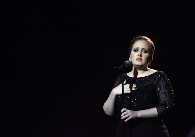 FILE - In this Feb. 15, 2011 file photo, Adele performs on stage during the Brit Awards 2011 at The O2 Arena in London. In December, Adele was nominated for six Grammy awards, including album of the y