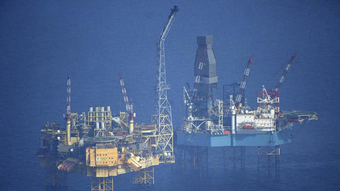 The Wednesday, March 28, 2012 aerial shot provided by Greenpeace shows Total's Elgin Wellhead Platform in the North Sea off the shore of Scotland.  A two-mile exclusion zone has been set up around the offshore platform in the North Sea which has been evacuated after a gas leak, Tuesday, March 27, 2012. The leak on Total's Elgin PUQ platform, about 150 miles (241km) off the coast of Aberdeen, led to the evacuation of all 238 workers on Sunday. (AP Photo / Greenpeace, Martin Langer)
