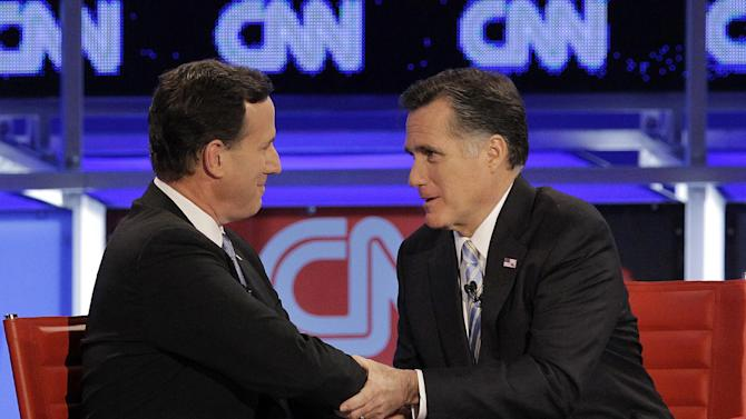FILE - In this Feb. 22, 2012 file photo, Republican presidential candidate, former Pennsylvania Sen. Rick Santorum, left, and former Massachusetts Gov. Mitt Romney talk following a Republican presidential debate in Mesa, Ariz. If he can manage it, now is the time for Mitt Romney to mend his Republican fences and bring around those dubious voters who kept spurning him for Rick Santorum, Newt Gingrich and others on the right. After a nasty Republican primary battle, he's got to somehow fire up the party's staunchest conservatives without alienating independent voters he'll need to defeat President Barack Obama in the fall.  (AP Photo/Jae C. Hong, File)