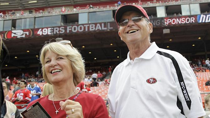 FILE- In this Sept. 11, 2011 file photo, Jackie and Jack Harbaugh, parents of San Francisco 49ers coach Jim Harbaugh and Baltimore Ravens coach John Harbaugh, stand before an NFL football game between the 49ers and the Seattle Seahawks in San Francisco.  The entire Harbaugh family already got its Super Bowl victory last Sunday, when each coach did his part to ensure a family reunion in New Orleans next week. The Ravens face off against the 49ers in the first Super Bowl coached by siblings on opposite sidelines. (AP Photo/Paul Sakuma, file)