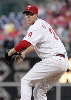 Halladay leads Phillies over Cardinals