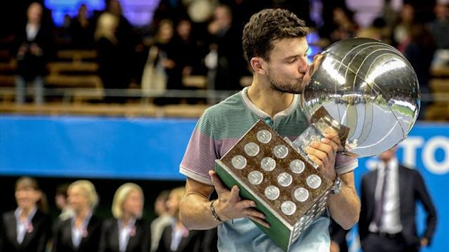 Bulgaria's Grigor Dimitrov kisses the trophy after winning the ATP Stockholm Open tennis tournament at the Royal Lawn Tennis Club in Stockholm October 20, 2013. (Reuters)