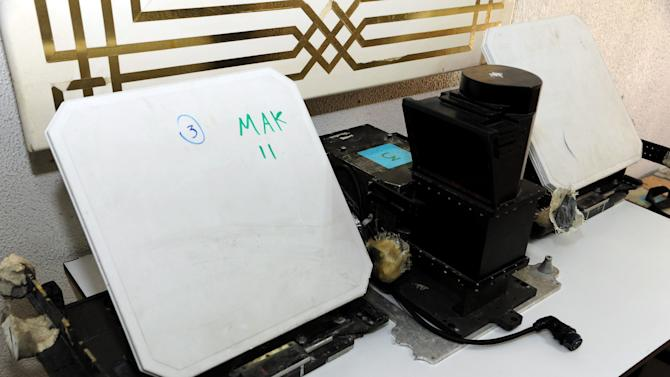 In this photo released by the Syrian official news agency SANA,  shows devices that were found in country's coastal region, northwest of Damascus, Syria, Thursday, March. 7, 2013. Syria's state-run media said were placed by Israel to spy on Syria. SANA's report says the devices are designed to photograph, register and transfer data. Syria and Israel are at a state of war and fought several battles over the past. (AP Photo/SANA)
