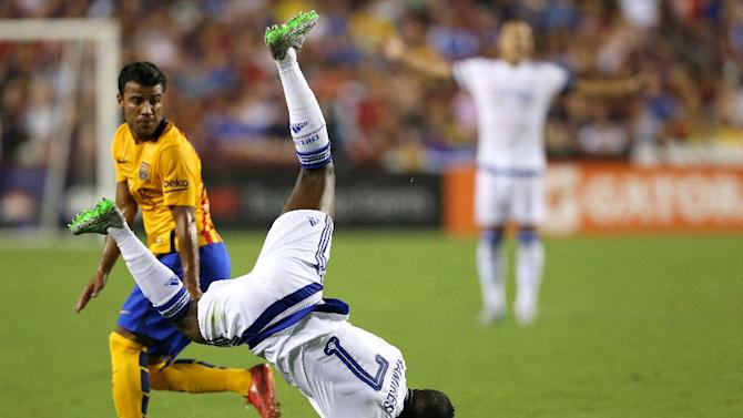 Chelsea's Ramires is upended by Rafinha of Barcelona during their International Champions Cup match on July 28, 2015 in Landover, Maryland