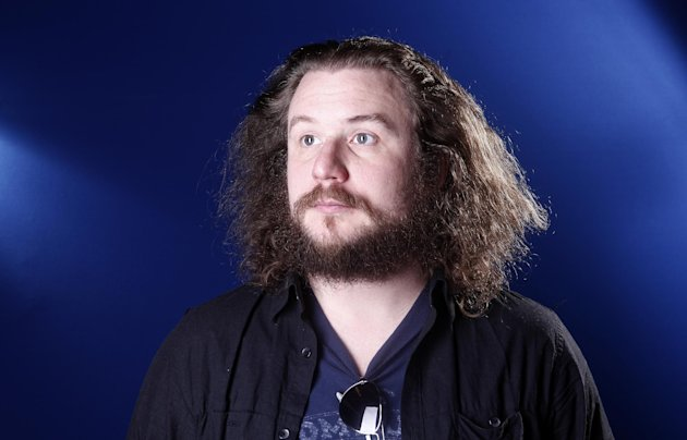 "FILE - This March 15, 2012 file photo shows musician Jim James in New York. James has picked ""Sleep No More"" as one of the stops on his tour promoting ""Regions of Light and Sound of God,"" his first full-length solo album. Now approaching its second year, ""Sleep No More"" has found itself evolving into a music destination in addition to a theatrical one. (AP Photo/Carlo Allegri, file)"