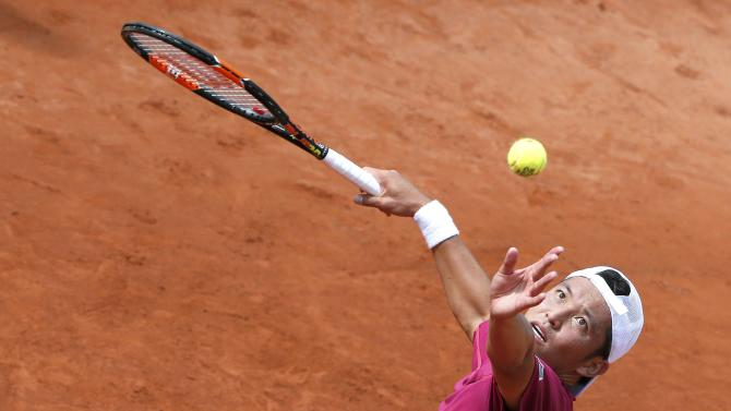 Japan's Tatsuma Ito serves to Fabio Fognini of Italy during their men's singles match at the French Open tennis tournament at the Roland Garros stadium in Paris