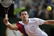 Serbia&#39;s Novak Djokovic returns a ball during his quarter-finals match against France&#39;s Jo-Wilfried Tsonga at the ATP Rome tournament. Djokovic won 7-5, 6-1