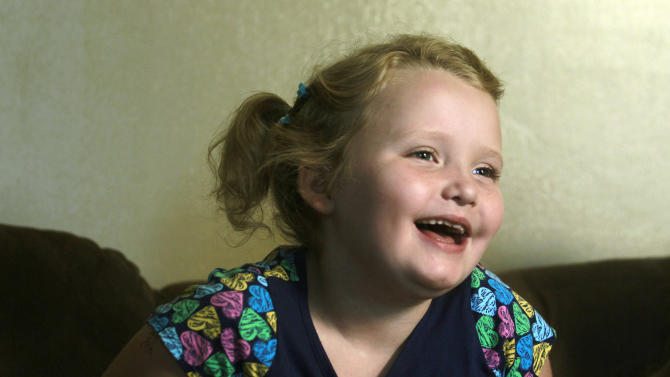 """FILE - In this Sept. 10, 2012 file photo, seven-year-old beauty pageant regular and reality show star Alana """"Honey Boo Boo"""" Thompson gestures during an interview in her home in McIntyre, Ga. (AP Photo/John Bazemore, file)"""