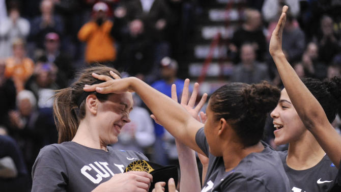 Connecticut's Breanna Stewart, left, celebrates with teammates after their 91-70 win over Dayton in a regional final game in the NCAA women's college basketball tournament Monday, March 30, 2015, in Albany, N.Y. (AP Photo/Tim Roske)