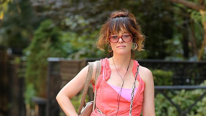 Actress Parker Posey pose for the camera along with her dog out in the West Village in New York City