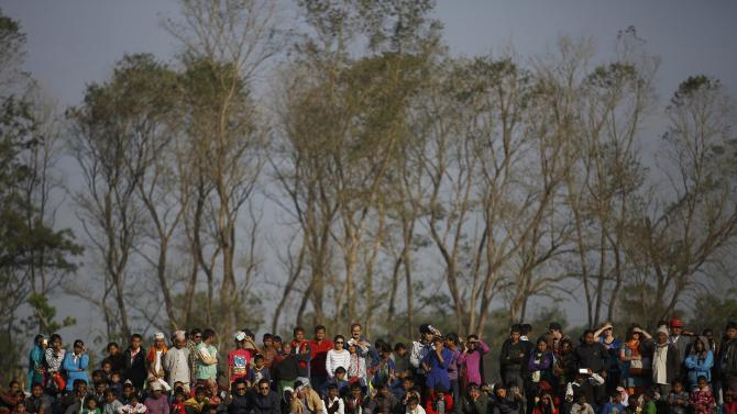 Spectators watch elephants playing a soccer match during an Elephant Festival event at Sauraha in Chitwan