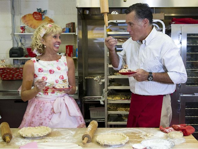 Linda Hundt, owner of Sweetie-licious Bakery, left, laughs as Republican presidential candidate, former Massachusetts Gov. Mitt Romney takes a bite of cherry pie during a campaign stop at Sweetie-lici
