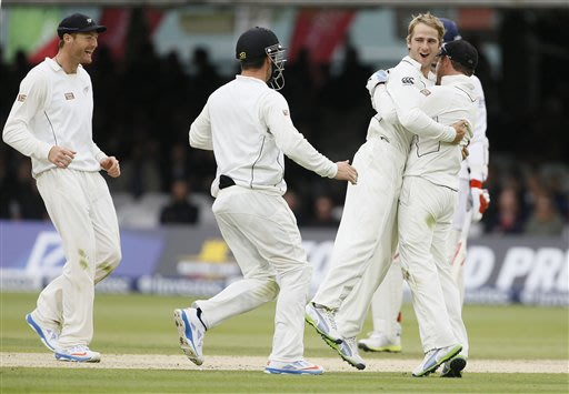 New Zealand's players celebrate the wicket of England's Jonathan Trott , bowled by Kane Williamson, second right, in their first test match, at Lord's cricket ground in London, Saturday, May 18, 2013