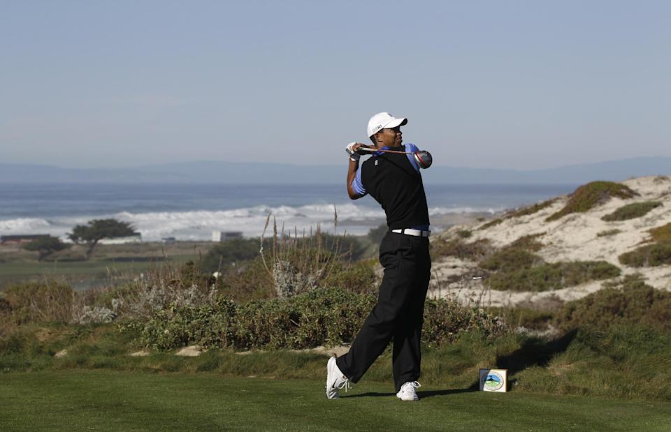 Tiger Woods hits from the sixth tee at Spyglass Hill Golf Course during the first round of the AT&T Pebble Beach National Pro-Am golf tournament in Pebble Beach, Calif., Thursday, Feb. 9, 2012. (AP Photo/Marcio Jose Sanchez)