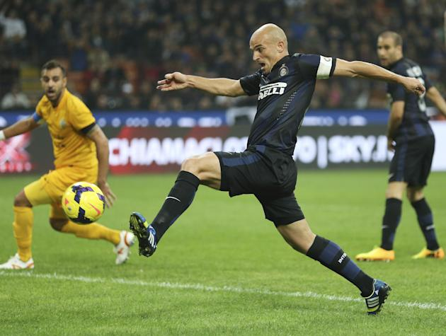 Inter Milan Argentine midfielder Esteban Cambiasso scores a goal during the Serie A soccer match between Inter Milan and Hellas Verona at the San Siro stadium in Milan, Italy, Saturday, Oct. 26, 2013