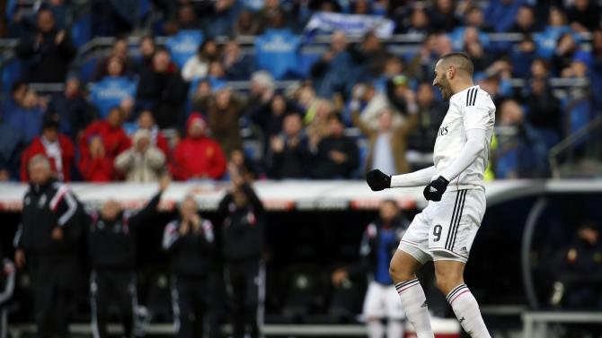 Real Madrid's Benzema celebrates his goal against Real Sociedad during their Spanish first division match in Madrid