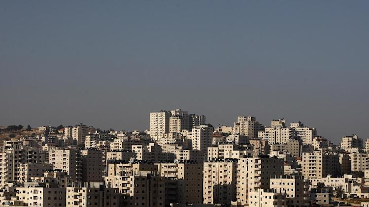 In this photograph taken on July 25, 2012, a general view of the Kufr Aqab  Jerusalem neighborhood is seen. Kufr Aqab is one of several Arab areas within Jerusalem's municipal borders that have been separated from the city by the security barrier Israel has built to wall off the West Bank. (AP Photo/Majdi Mohammed)